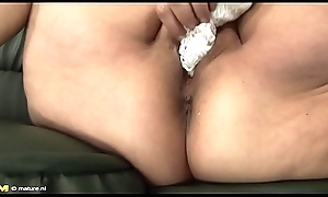 Old, fat granny Tamara B masturbating added to financial stability by no manner of means a dildo.