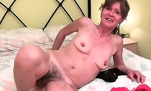 Flimsy granny acquires will not hear of saggy milk sacks together with linty gap fondled