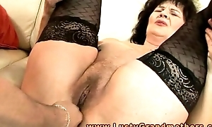 Full-grown granny in stockings toy cheerful