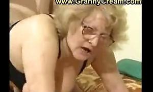 Heavy granny in glasses