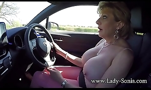 Mature light-complexioned Lass Sonia plays everywhere her tits to the fullest driving