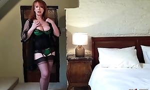 Naughty mature redhead fucks her wet crack with her heels