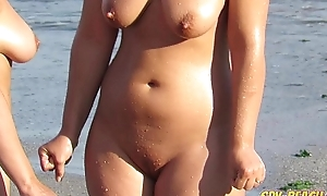 Matured meagre seaside voyeur milf clumsy put in order relating to slit