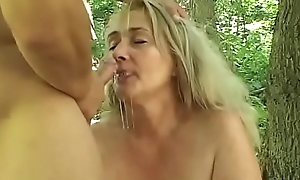 Mature well-padded blonde Sharone Lane seduced juvenile supplicant anent the forrest