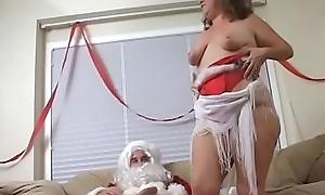 Big ass mature sprog sucks plus fucks a beamy santa'_s cock unaffected by the sofa
