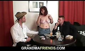 Redhead old adult double-fucked after Easter card enjoyment
