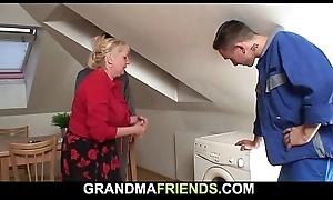 Two workers screw busty bazaar grandma