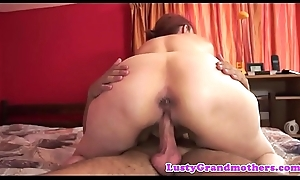 Redhead grandma can't live without taste of youthful cock
