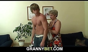 Old grandma swallows his chubby dick