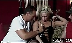 Gorgeous hooker puts condom in excess of schlong and gives hawt blowjob